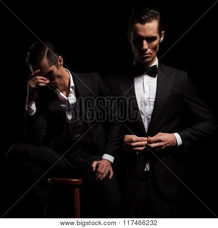 2 poses of elegant businessman in black suit with bowtie. one seated thoughtful insecure and one confident closing his jacket.