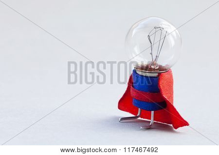 Light bulb super hero dressed in blue suit and red cape. Success man creative concept, fun, kind cha