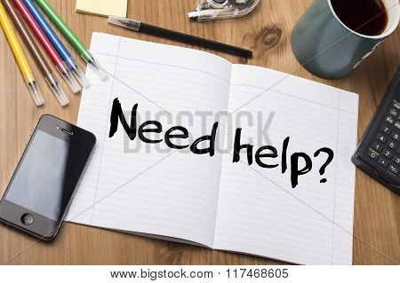Need Help? - Note Pad With Text On Wooden Table