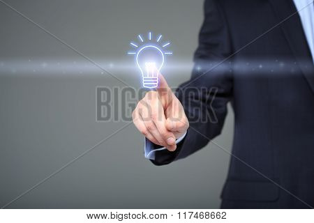 technology and internet concept - businessman pressing button with bulb on virtual screens