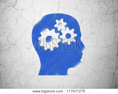Marketing concept: Head With Gears on wall background
