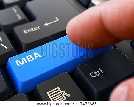 Pressing Blue Button MBA on Black Keyboard.