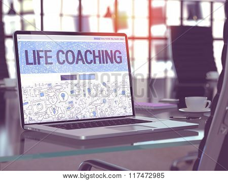 Life Coaching on Laptop in Modern Workplace Background.