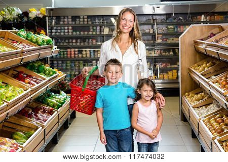 Portrait of smiling family in grocery store