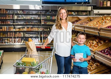 Portrait of mother and son in grocery store