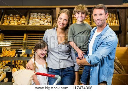 Portrait of family doing shopping in grocery store
