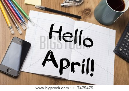 Hello April! - Note Pad With Text On Wooden Table