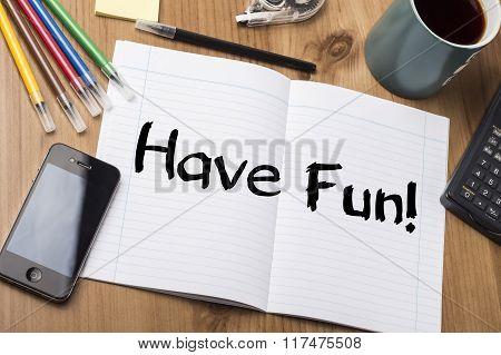 Have Fun! - Note Pad With Text On Wooden Table