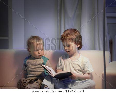 happy boy read book home