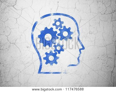 Studying concept: Head With Gears on wall background