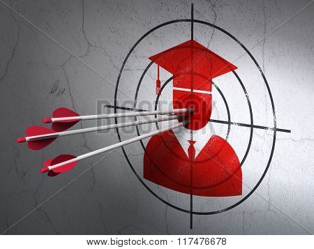 Education concept: arrows in Student target on wall background