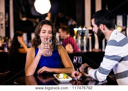 Couple having a drink in a bar