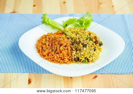 Delicious Dish Made Of Two Kinds Of Rice On A White Plate