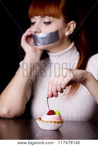 The Girl, Whose Mouth Sealed With Tape Sad Looking At Cakes