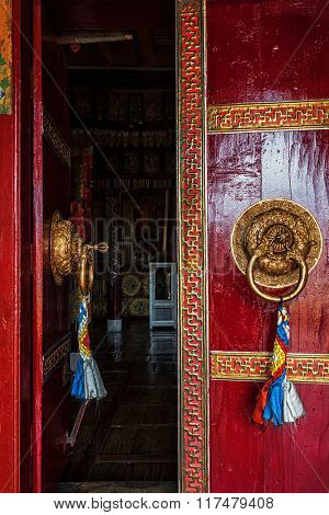 Open leaf of gate of Spituk Gompa (Tibetan Buddhist monastery) with ornamented decorated door handle. Ladakh, India