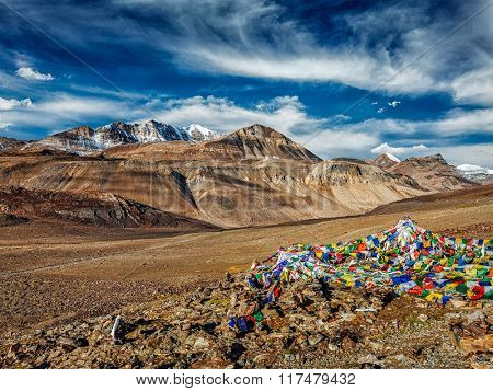 Buddhist prayer flags (lungta) on top of Baralacha La pass on Manali-Leh road. Baralacha La Pass, Himachal Pradesh, India
