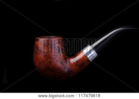Smoking pipe on a black