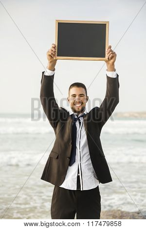 Business young man in outdoor holding a chalkboard