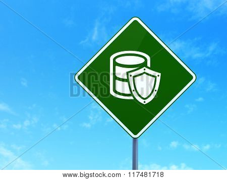 Software concept: Database With Shield on road sign background