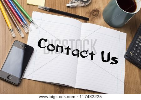 Contact Us - Note Pad With Text On Wooden Table
