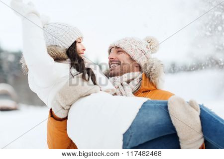 people, season, love and leisure concept - happy couple outdoors in winter