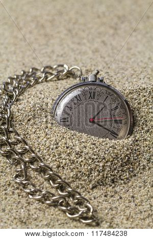 Clock With Chain On Sand.