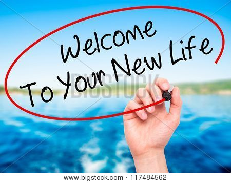 Man Hand Writing Welcome To Your New Life With Black Marker On Visual Screen