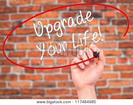 Man Hand Writing Upgrade Your Life!  With Black Marker On Visual Screen