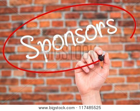 Man Hand Writing Sponsors  With Black Marker On Visual Screen