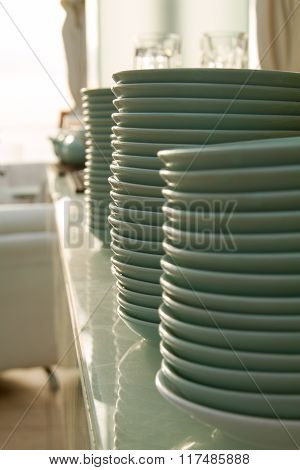 A Stack Of Plates On The Front Of The Restaurant