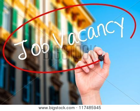 Man Hand Writing Job Vacancy With Black Marker On Visual Screen