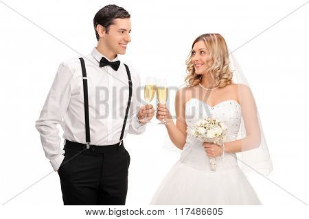 Studio shot of a newlywed couple making a toast with white wine isolated on white background