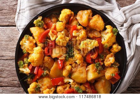 Indian Cuisine: Gobi Aloo Close-up On A Plate. Horizontal Top View