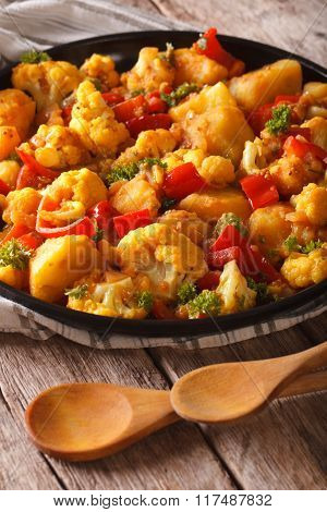Cauliflower With Potatoes In Curry Sauce On A Plate Close-up. Vertical