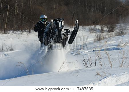 Man on snowmobile in winter mountain