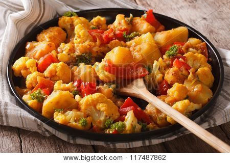 Gobi Aloo Cauliflower And Potatoes Close Up On A Plate. Horizontal