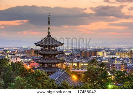 Nara, Japan pagoda and cityscape at dusk.