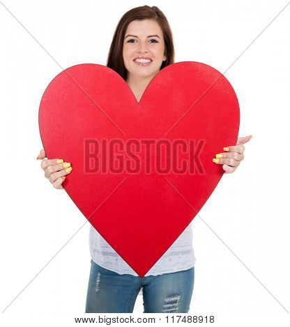 happy teen girl showing heart shape against white background