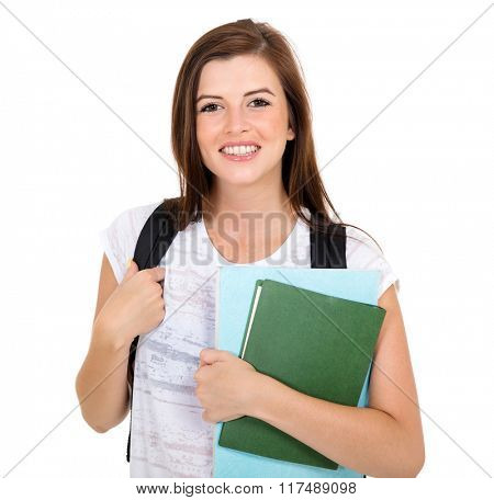 portrait of cute young college girl holding books