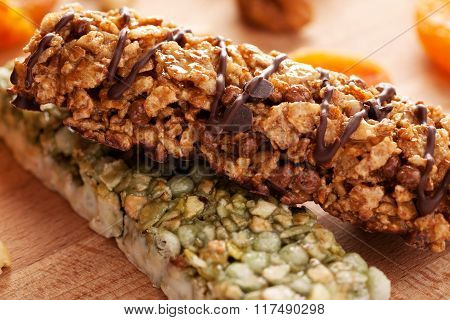 Granola Bars On Wooden Board With Fruits