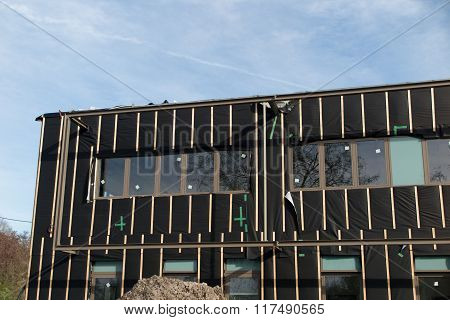 Work On Insulation  Facades High-rise Building. Warming  Modern Construction Technology