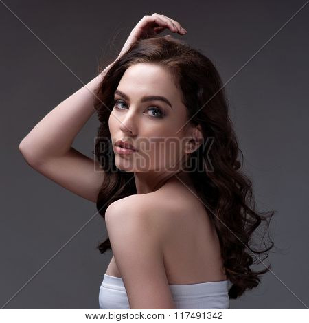 Portrait Of Wonderful Young Woman With Long Hair Looking At Camera, Smiling