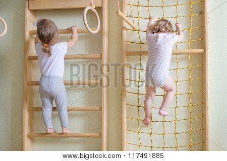 Baby Toddlers Climbing Up The Stairs.