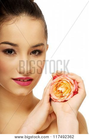 Beautiful woman with pink rose.