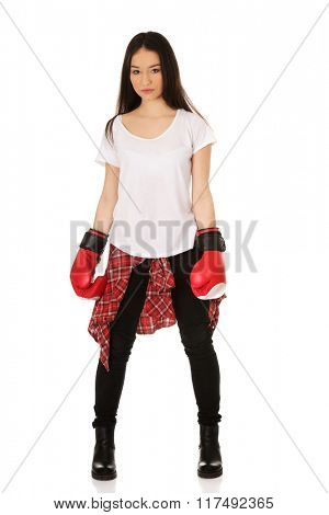 Young woman wearing boxing gloves.