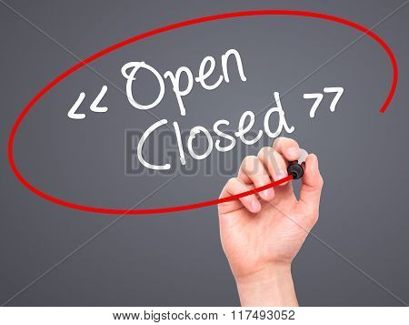 Man Hand Writing Open - Closed With Black Marker On Visual Screen