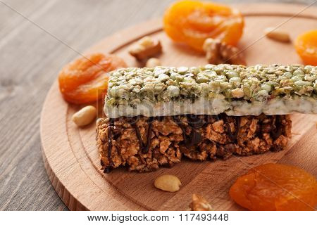 Two Granola Bars On Wooden Board Close-up