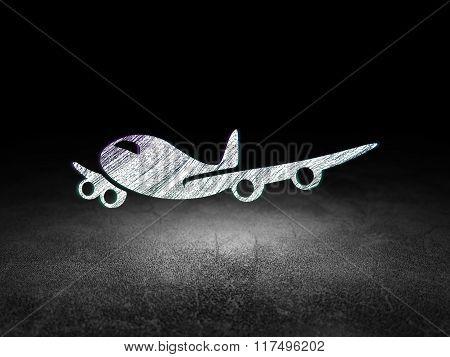 Vacation concept: Airplane in grunge dark room