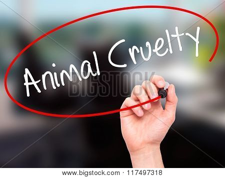 Man Hand Writing Animal Cruelty With Black Marker On Visual Screen