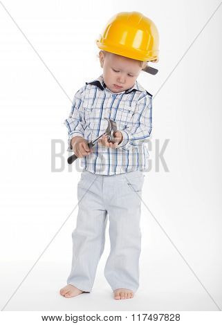 boy in protective helmet and hammer